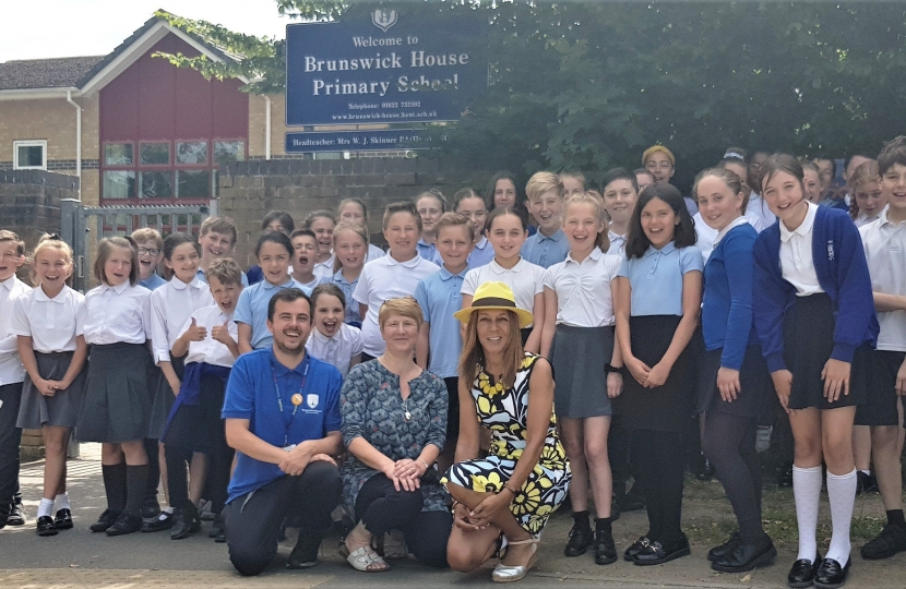 Helen with year 6 staff and students at Brunswick House Primary